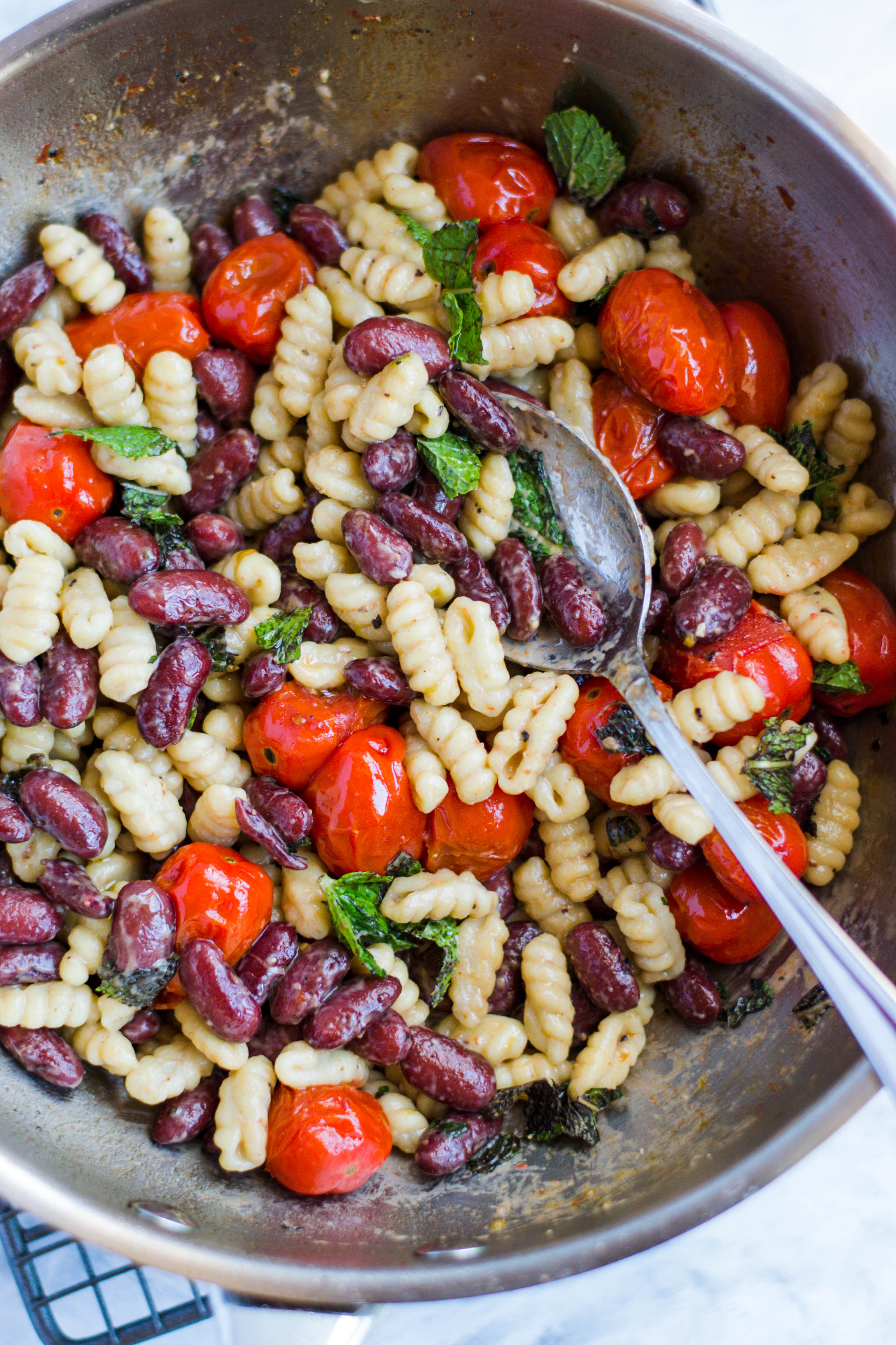 Pasta with beans, tomatoes, and cheese
