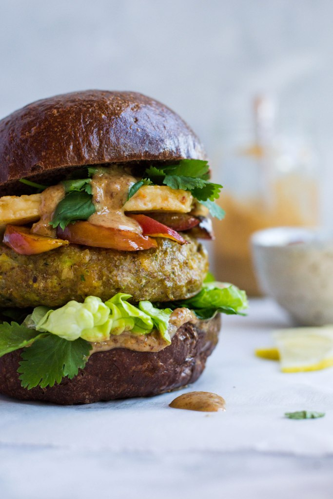 Chickpea veggie burgers with fried halloumi and peaches