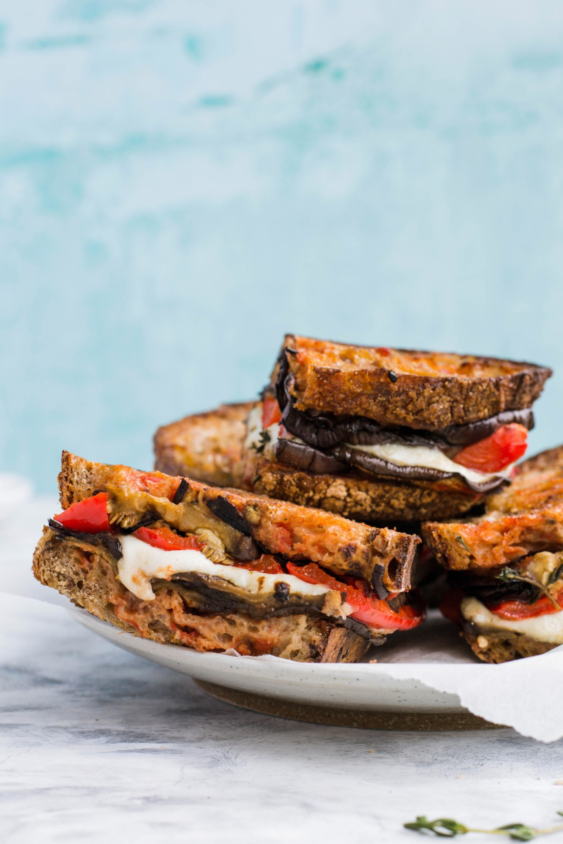 "This vegetarian sandwich has a lovely combination of most of the typical Summer flavours and it gets all the extra points for being super easy to make! Featuring seasonal ingredients such as tomatoes, red peppers, aubergines, and a good handful of fresh thyme, it perfectly embraces my philosophy of ""get the most out of each season"". You can also easily adapt this sandwich to your needs using, for example, some gluten-free bread or a dairy-free mozzarella. Recipe on amatterofnourishment.com"