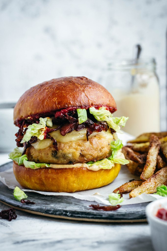 Easy tuna burgers with capers served in a soft brioche burger bun made with turmeric