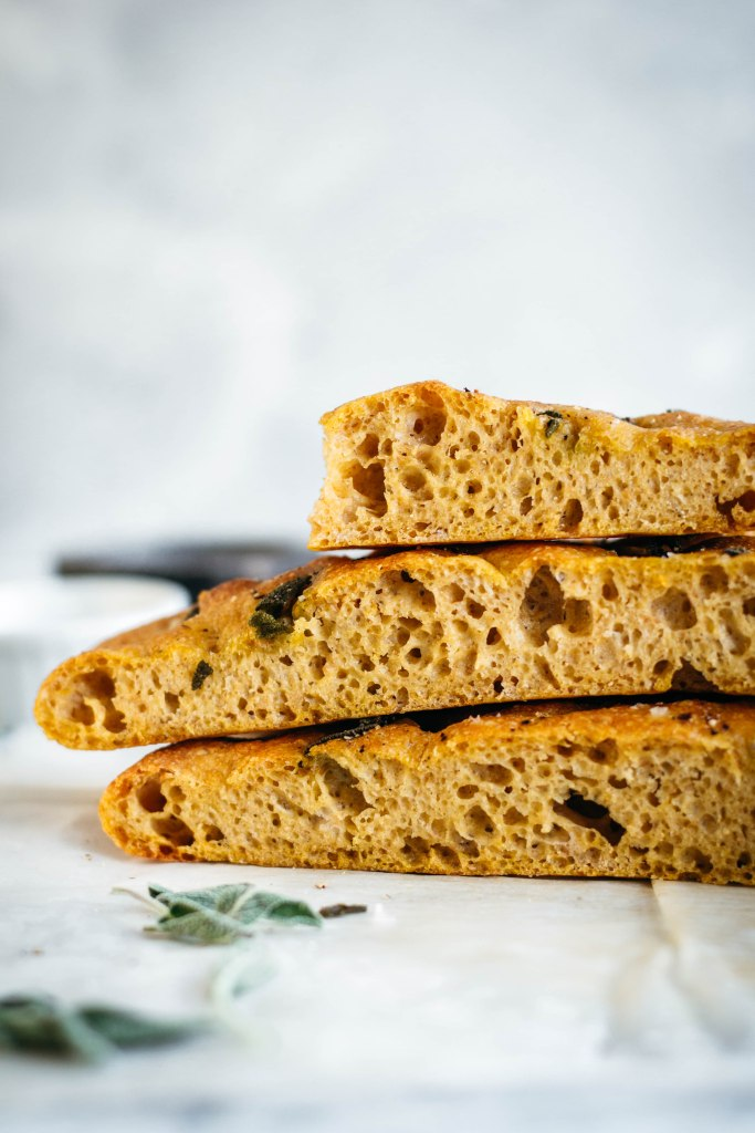 Delicious even when eaten on its own, this soft vegan pumpkin focaccia has a sweet finish and a pillowy texture, that may help this one to easily become one of your favourite recipes!